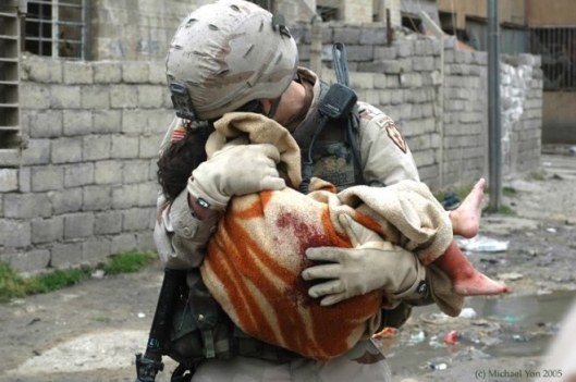 bed92-soldier-cradles-child-victim-of-terrorists